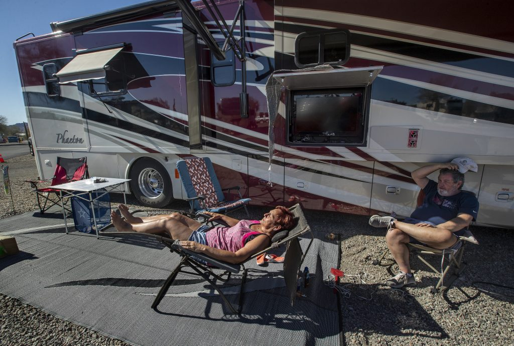 Janna Wilson, 64, and her husband John, 66, sunbathe next to their 40 foot long motorhome located at Quail Run RV Park in Quartzsite, Arizona. They have been full time RVers since June of 2020.