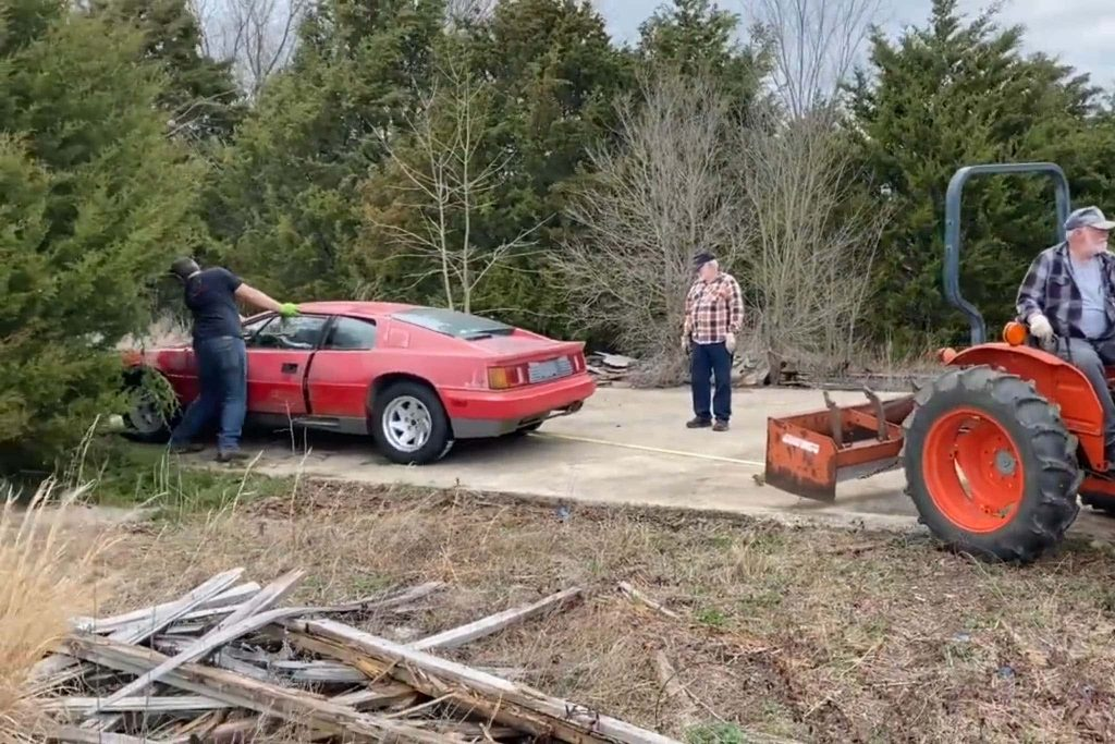 a 1988 Lotus Esprit barn find getting pulled out of a field