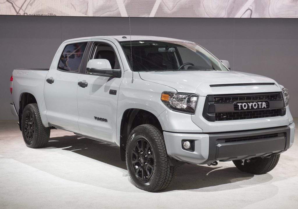 A white Toyota Tundra parked at an auto show.