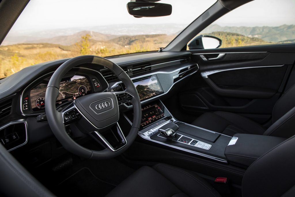 Black leather interior of the 2021 Audi A6 looking in from the driver's side window