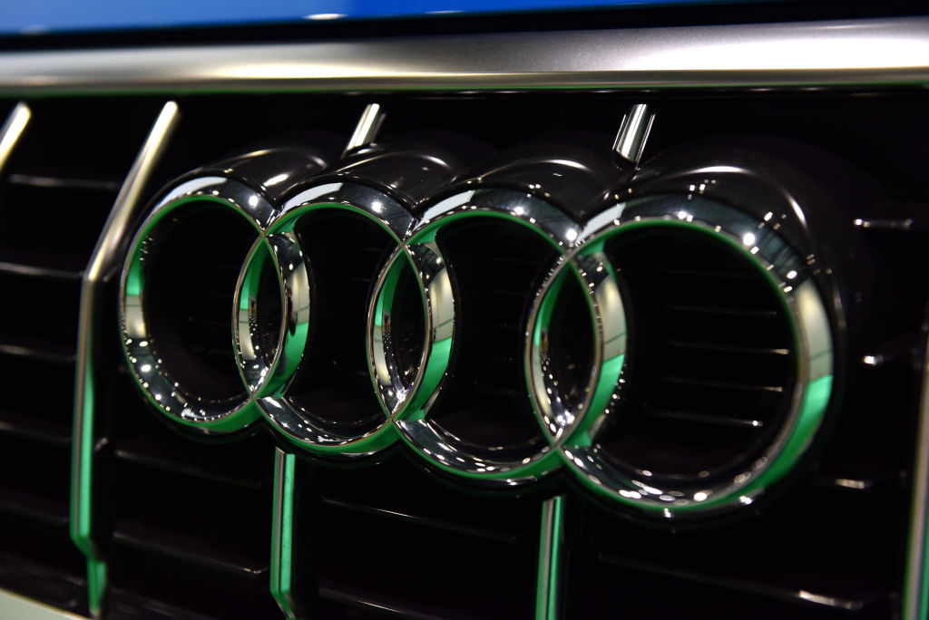A close up of the four rings of the Audi badge on a front grille