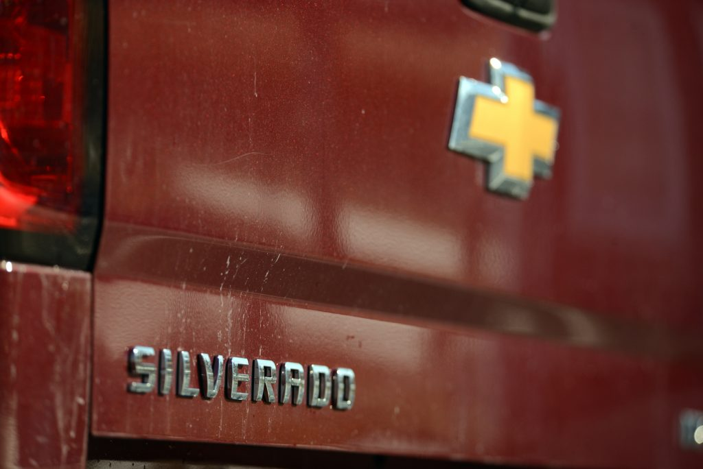 tailgate of a red 2014 Chevy Silverado