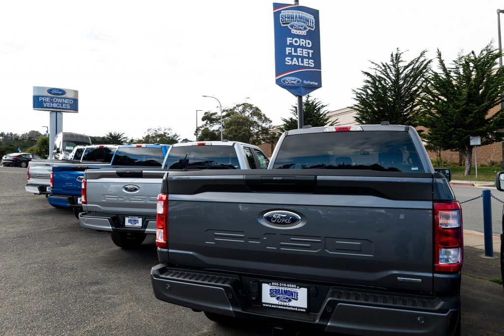 The back end of several 2021 ford f150 pickup trucks