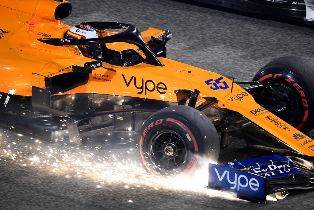 An f1 car scraping against the track