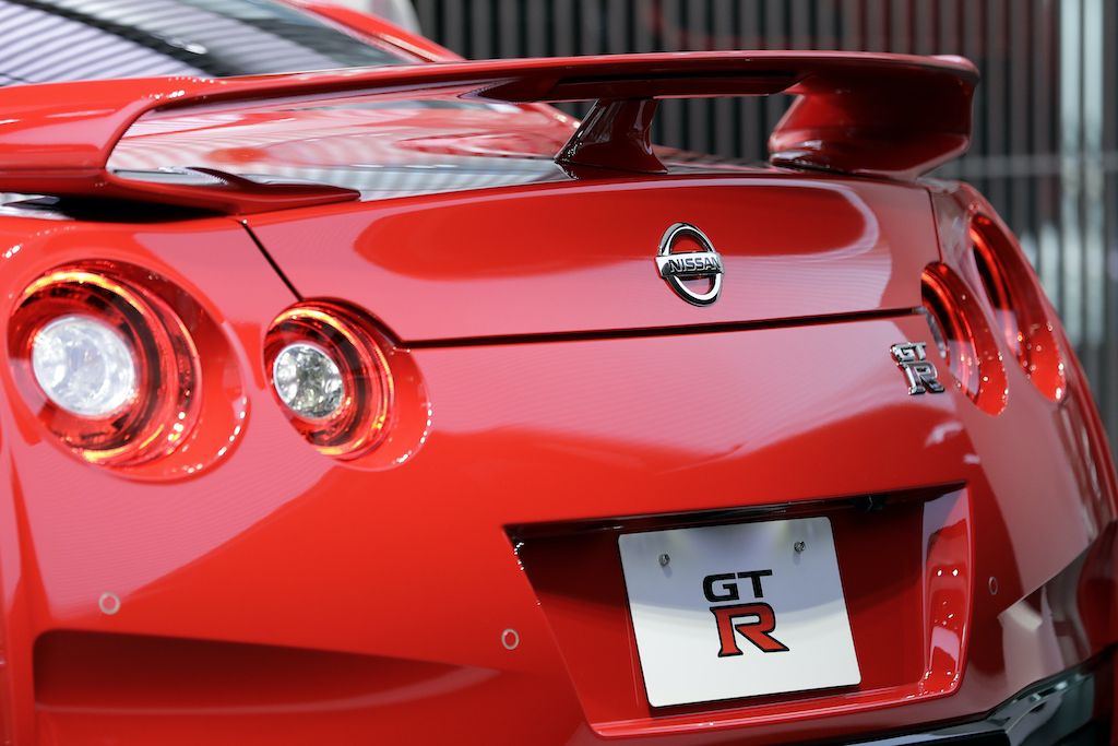 The back end of a red nissan gtr