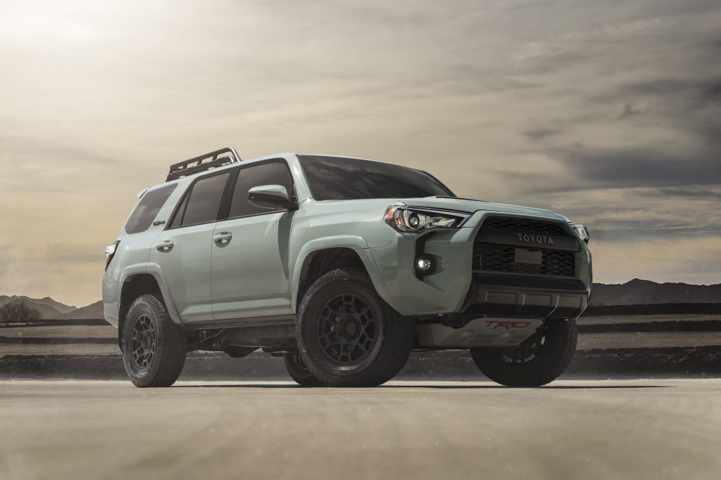 The 2021 Toyota 4Runner TRD Pro SUV in the Lunar Rock color in a press photo desert scene