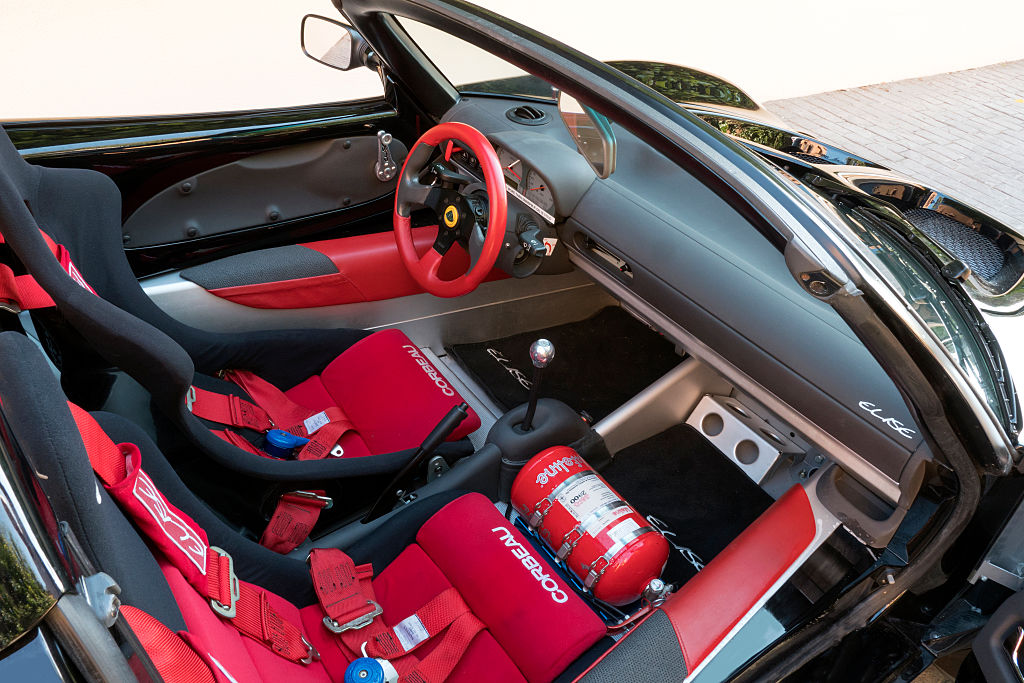 The black and red interior of a Lotus Elise