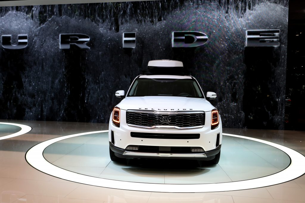 The front end of a white kia telluride on display