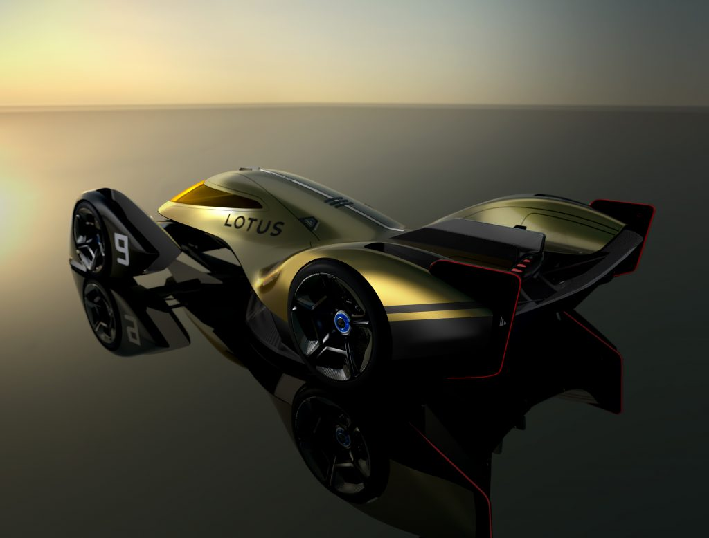 A rear shot showing off the aerodynamics of the new Lotus E-R9 race car in gold and blakc