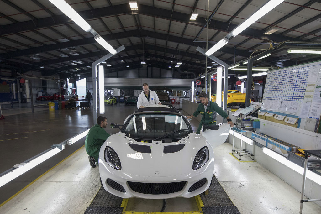 A white Lotus elise on the assembly line