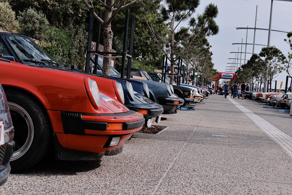 """The biggest classic car race of Belgium """"Tour Amical"""" reached the city of Thessaloniki . The road is filled with air-cooled Porsche 911 models"""