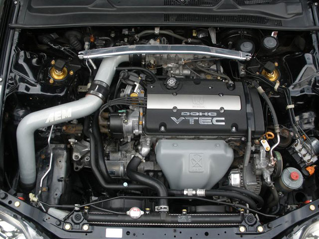 A picture of A Honda Prelude with a wire-tucked engine bay