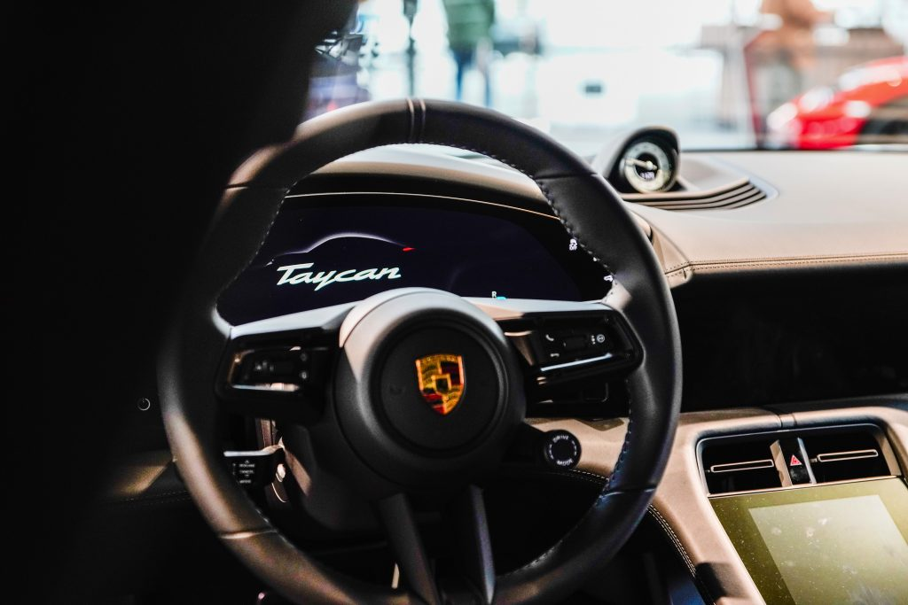 The steering wheel and dashboard for the Porsche Taycan interior