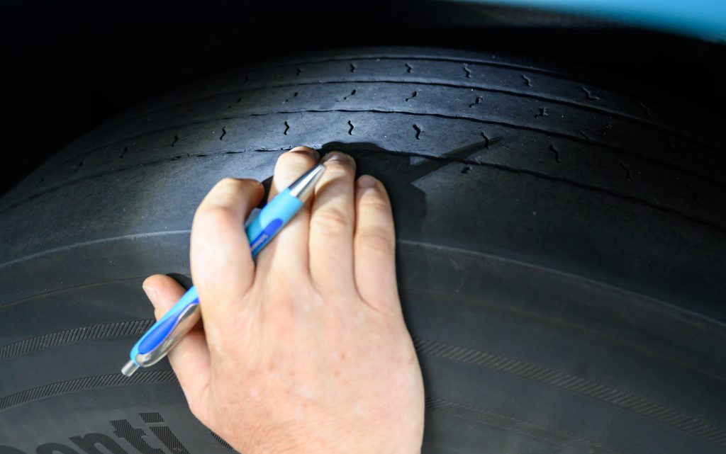A quick tread check on a worn tire