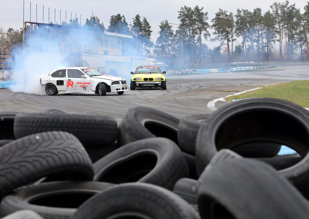 Two cars drifting around the track