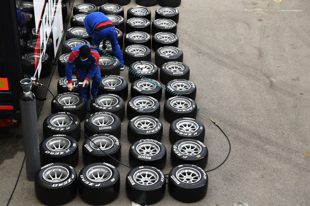 An aerial view of racing tires lines up in rows