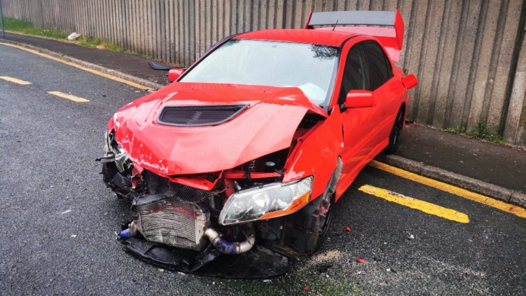 Dream Car Giveaway 2006 Mitsubishi Lancer Evo 9 in red after getting destroyed