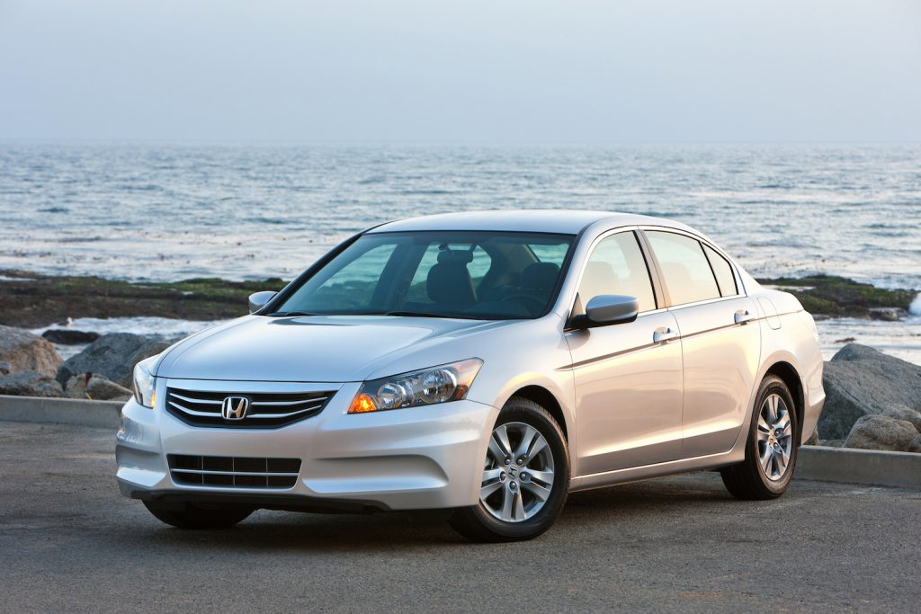 A silver 2011 Honda Accord parked by the waterfront