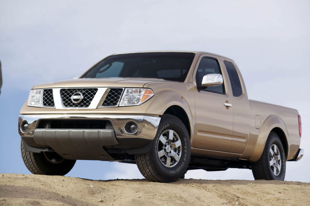 An image of a Nissan Frontier parked outdoors.