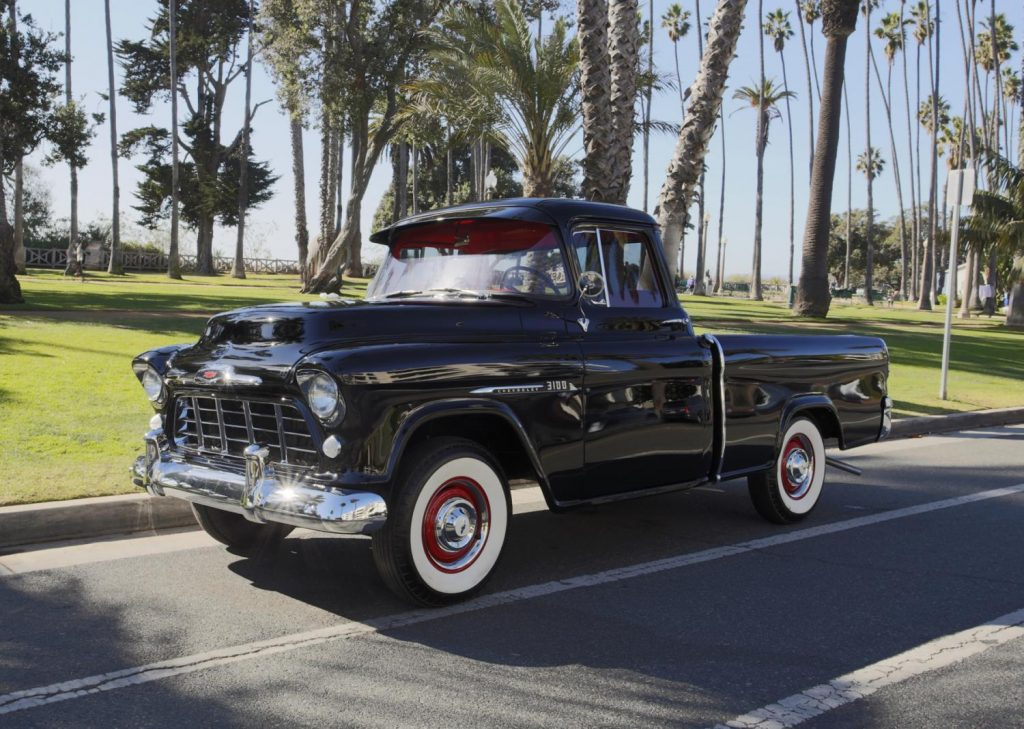 profile of a black 1956 Chevy pickup truck