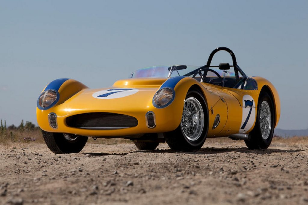 The yellow-with-blue-stripes 1961 Old Yeller VII in the desert