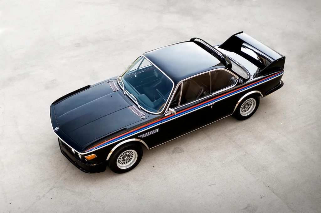 An overhead view of a black-red-blue 1975 BMW 3.0 CSL 3.5 with Batmobile kit
