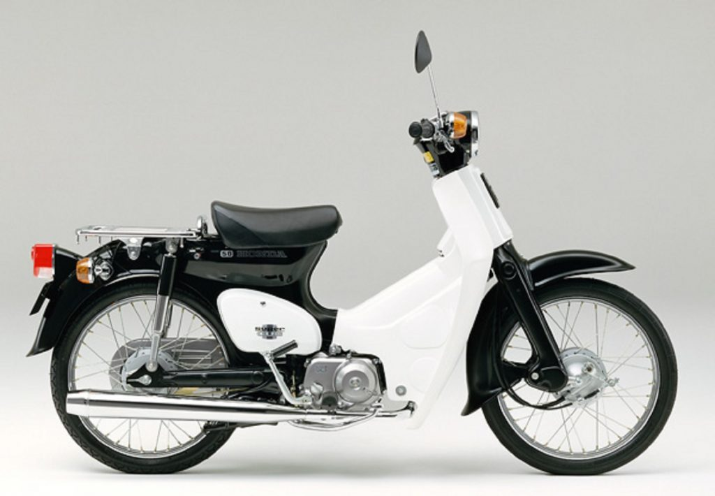 A side view of a black-and-white 1991 Honda Super Cub C50