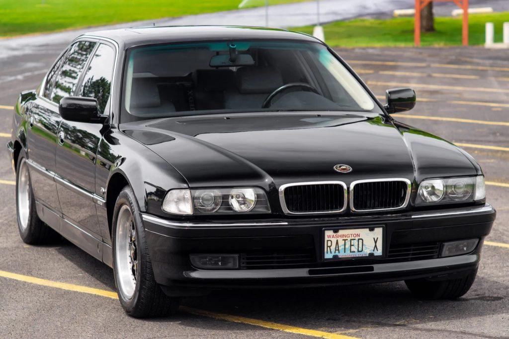 A black 1998 BMW 740iL in a parking lot