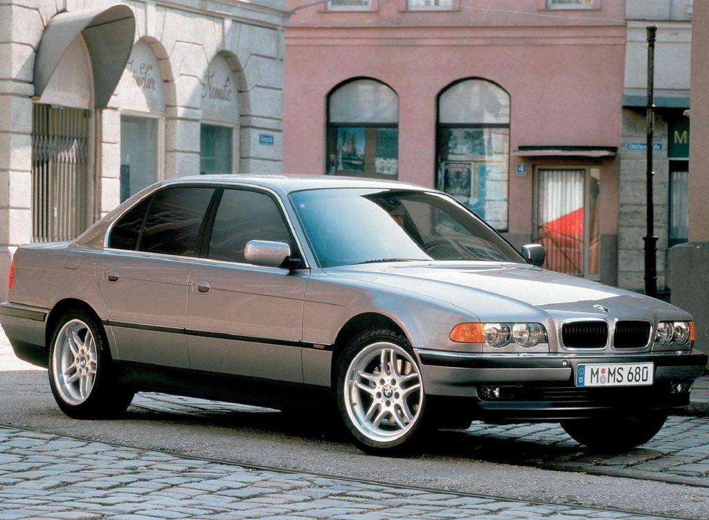 A silver 1999 E38 BMW 740i in a European city