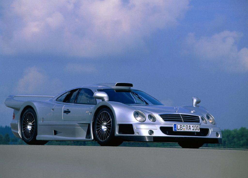 A silver 1999 Mercedes CLK GTR on a racetrack