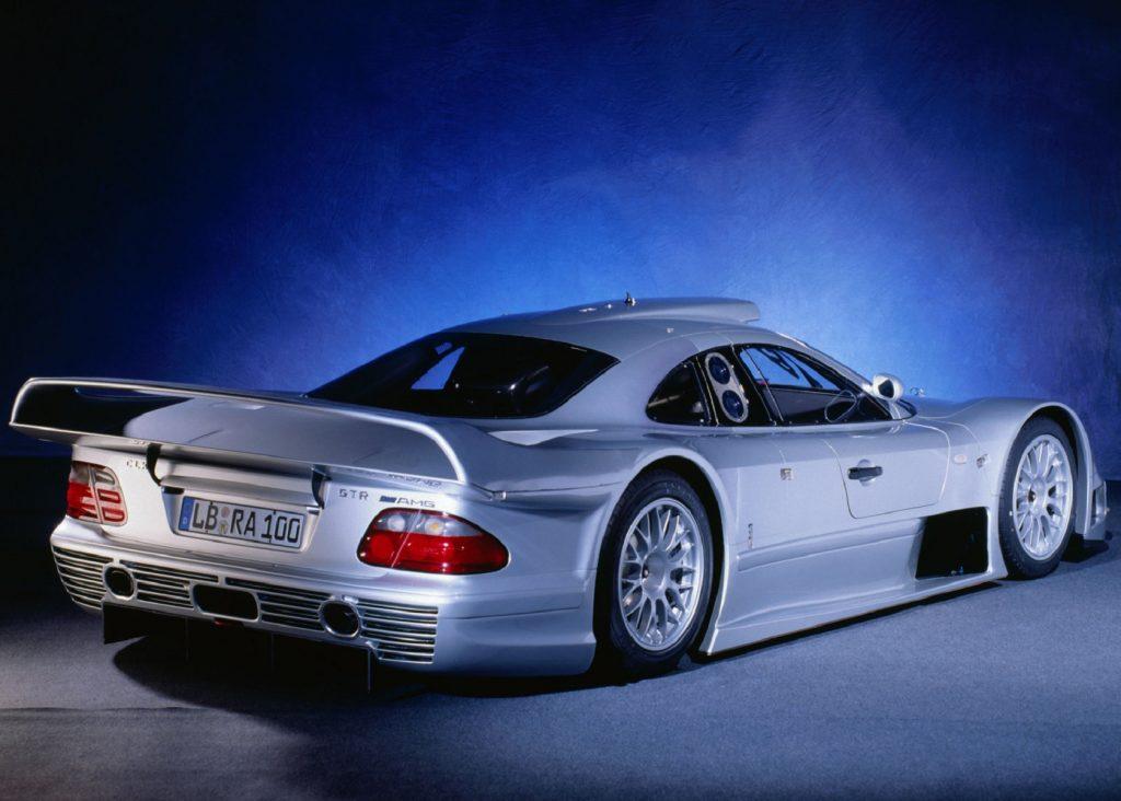 The rear 3/4 view of a silver 1999 Mercedes CLK GTR