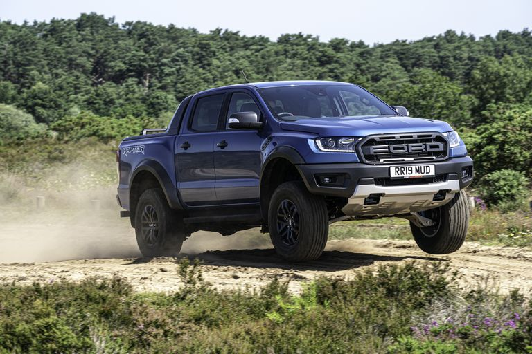 Ford Ranger Raptor jumping on a scenic sandy off-road trail