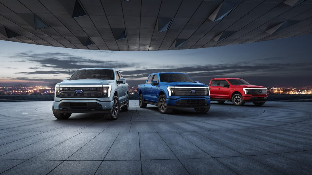 An image of a 2022 Ford F-150 Lightning parked outdoors.