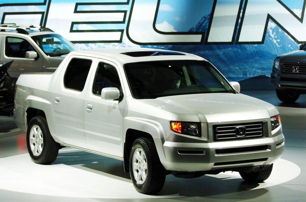 A silver 2006 Honda Ridgeline pickup truck on display