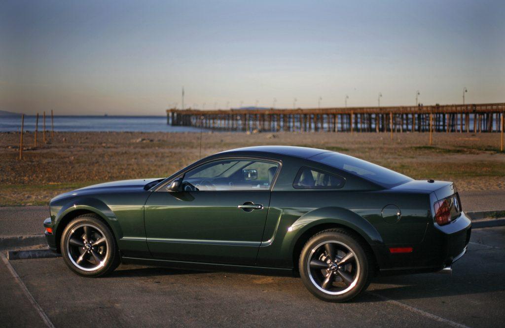 a side shot of a 2008 Mustang Bullitt at the beach