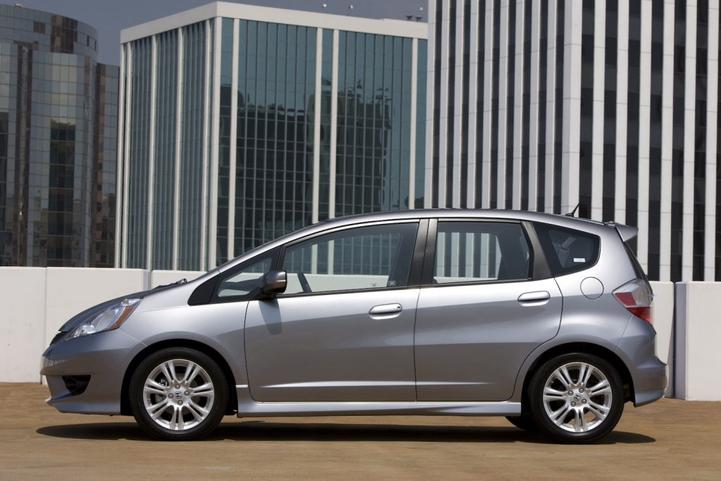 A silver 2009 Honda Fit parked, the Fit is one of the best cheap used cars under $5,000
