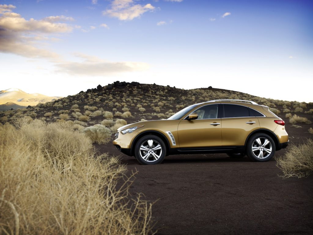 A brown 2009 Infiniti FX parked in the wilderness
