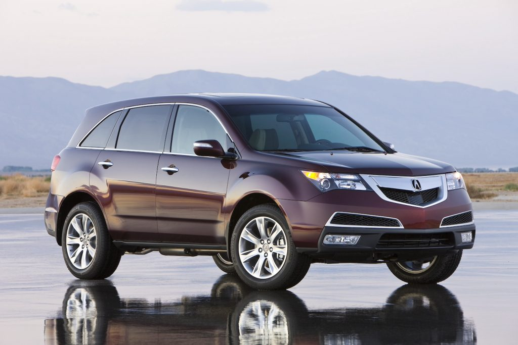 A 2011 Acura MDX parked by mountains