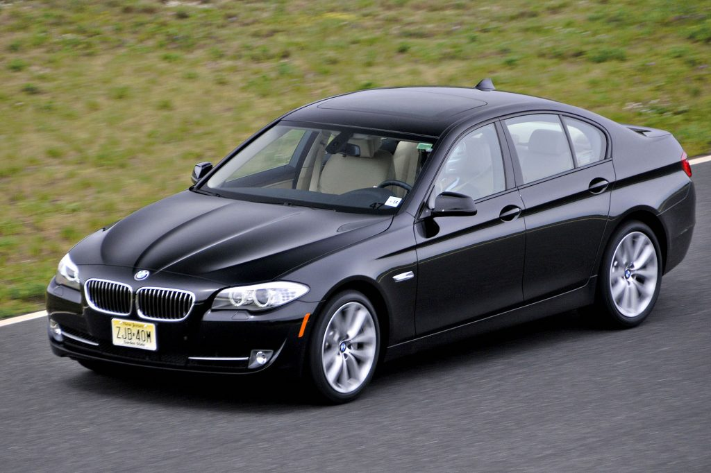 A black 2011 BMW 550i sport sedan is driven at New Jersey Motorsport Park in Millville, New Jersey, on Tuesday, May 11, 2010