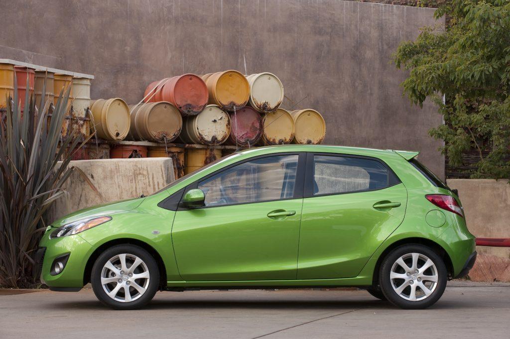 A lime green 2011 Mazda2