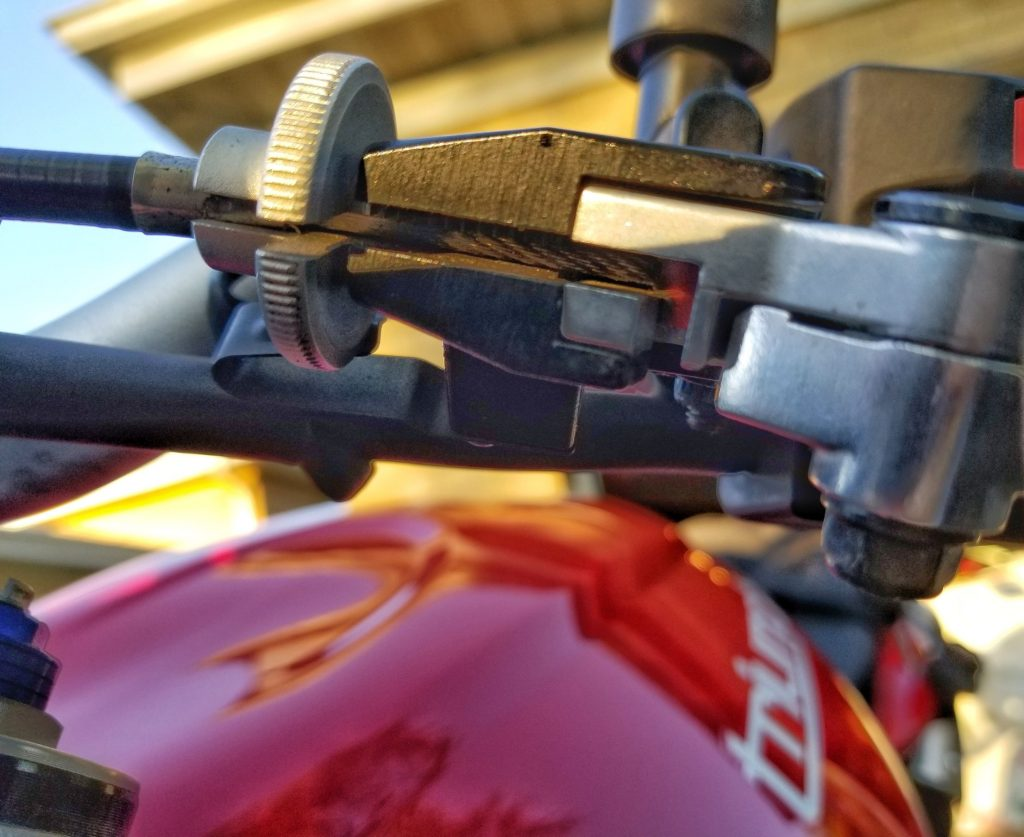 A closeup view of the clutch cable and lever on a 2012 Triumph Street Triple R