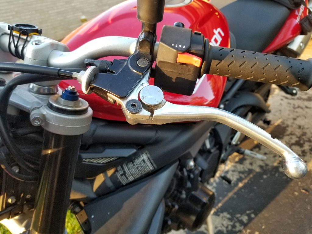 The clutch lever on a red 2012 Triumph Street Triple R