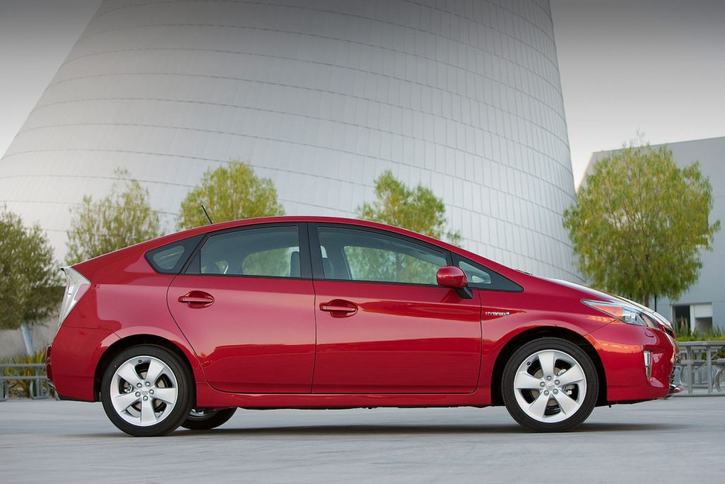 A red 2012 Toyota Prius, one of KBB's picks for the best affordable used cars