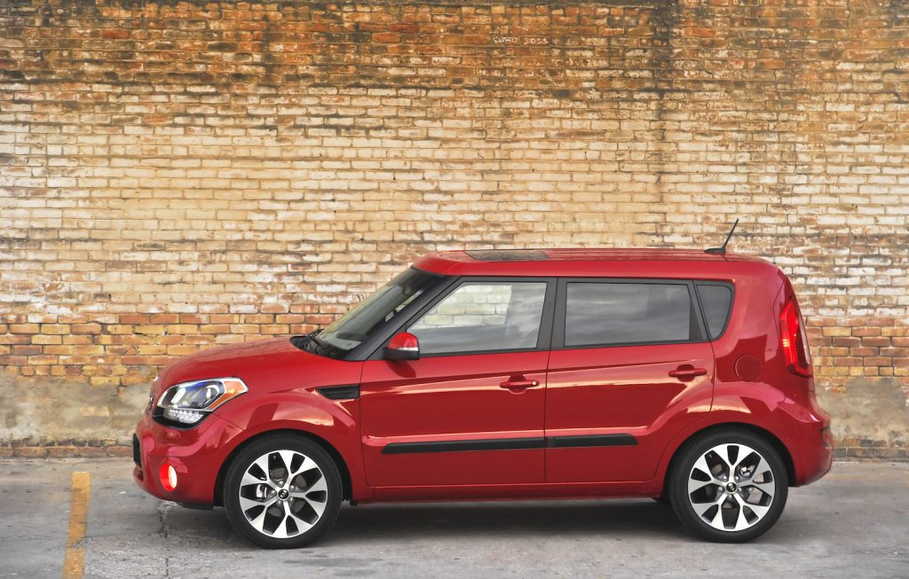 A red 2013 Kia Soul parked, the 2013 Kia Soul is one of the best used cars under $10,000