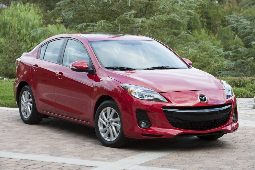 A red 2013 Mazda3