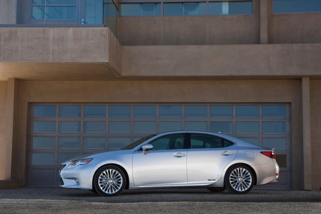 A silver 2013 Lexus ES parked, the Lexus ES is one of the best used luxury cars under $20,000