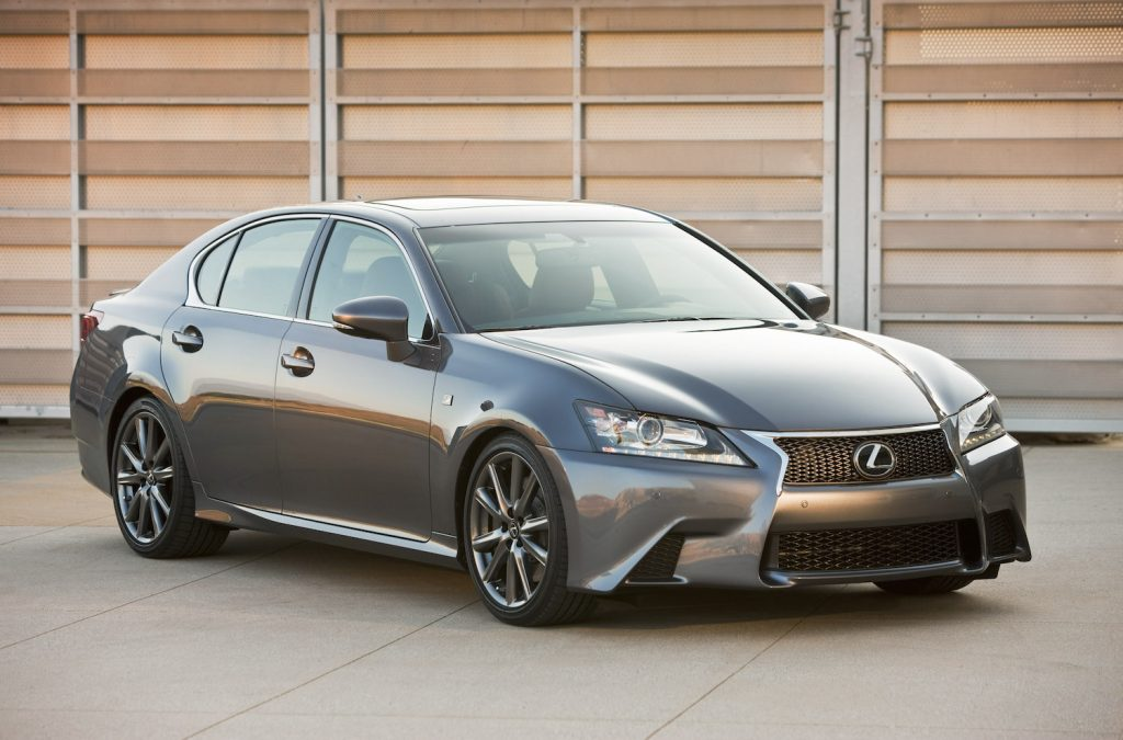 A 2013 Lexus GS parked in front of a garage