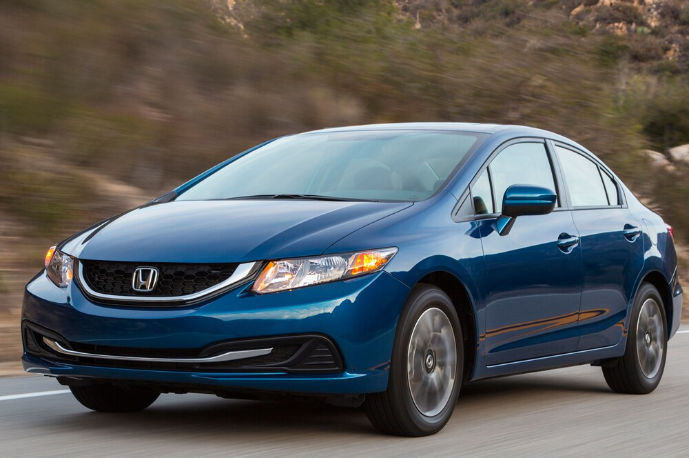 A blue 2015 Honda Civic, Consumer Reports pick for a great city car, rolls up a canyon road