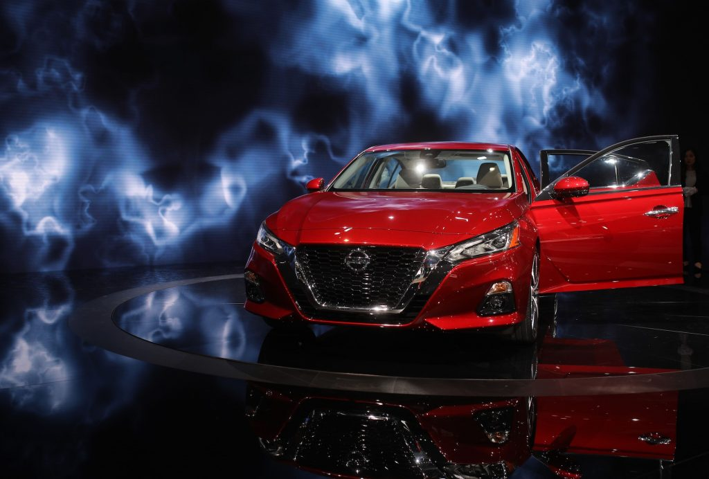 A red 2019 Nissan Altima midsize sedan on display at the New York Autoshow on March 29, 2018, in New York