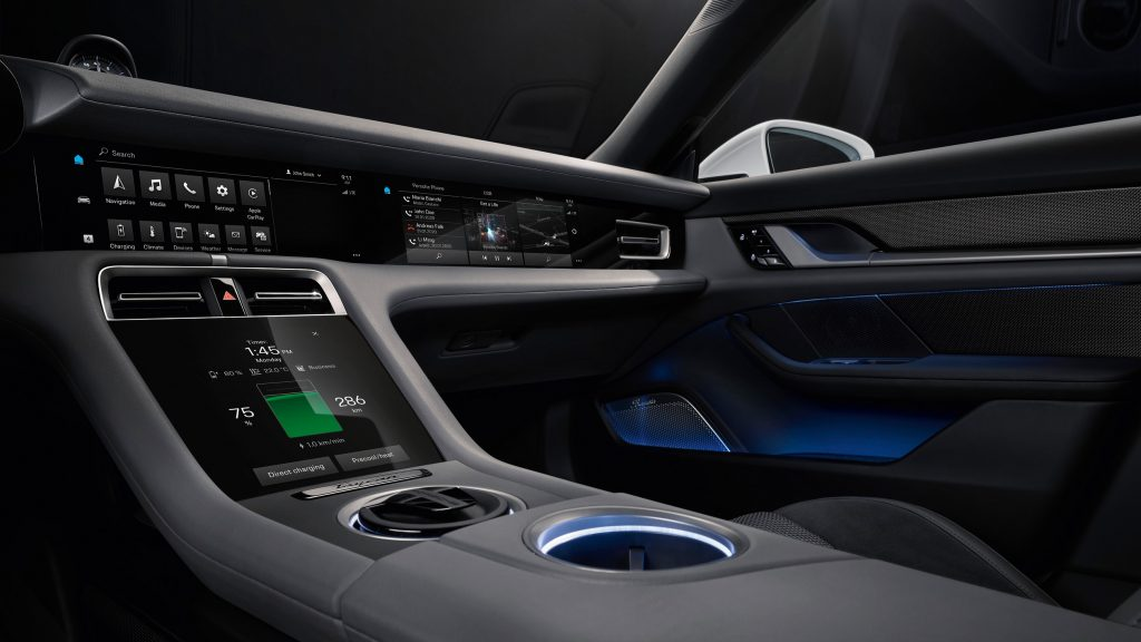 The dashboard of a 2019 Porsche Taycan with a close view of the battery charge indicator display